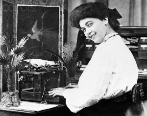 1904 --- Original caption: 1904- Picture shows a secretary at a typewriter, from a mutoscope still. --- Image by © Bettmann/CORBIS